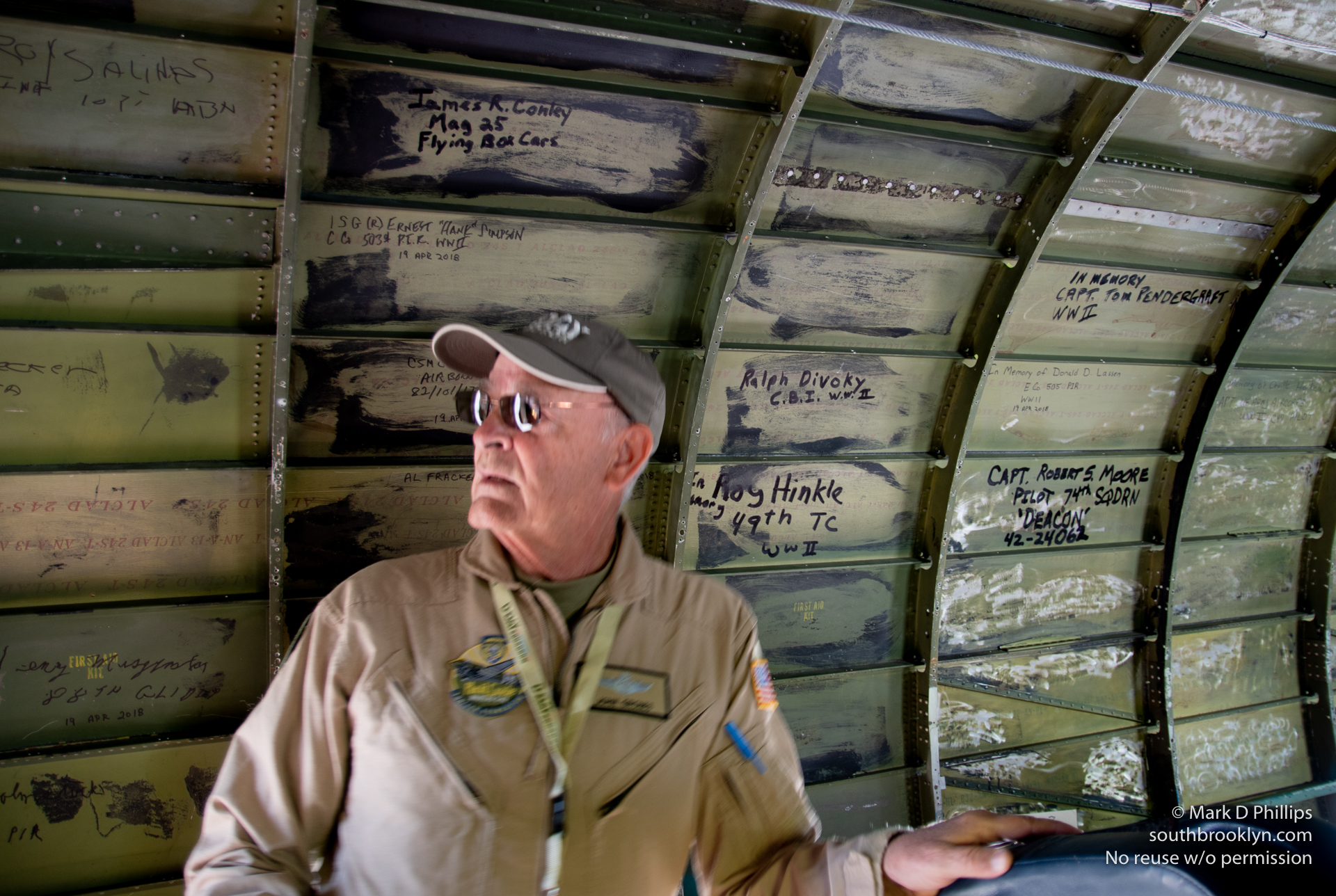 Eric Zipkin, Director of Operations and Pilot of Placid Lassie, with tributes on the interior of the c47. ©Mark D Phillips