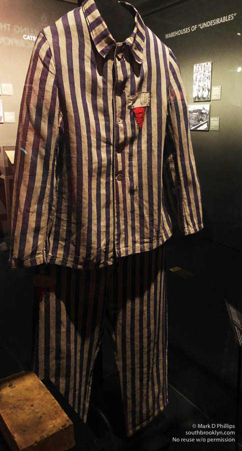 A set of black-and-white striped pajamas, once worn by a faceless person at Auschwitz. ©Mark D Phillips