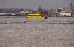 A ferry passes through the ice which filled the catch basin and into New York Harbor at Brooklyn Bridge Park. ©Mark D Phillips